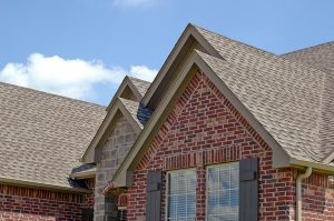Close up of gray shingles on the roof of a nice house
