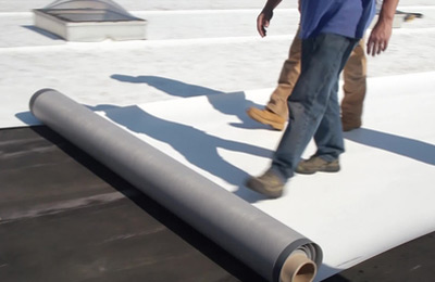 Roofers repairing a commercial roof