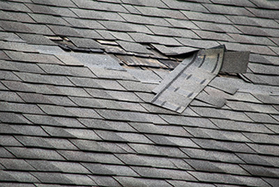 Damaged roof in need of repair