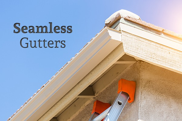 "The top corner of a house with seamless gutters beside the words ""Seamless Gutters"""