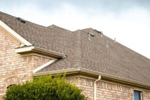 Up close detailed photo of new shingles on brick home