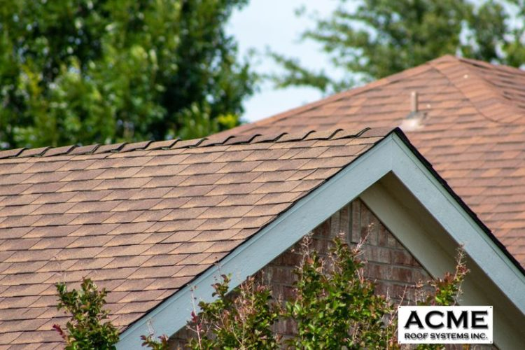 Close-up of a new roof with the Acme Roof Systems logo.