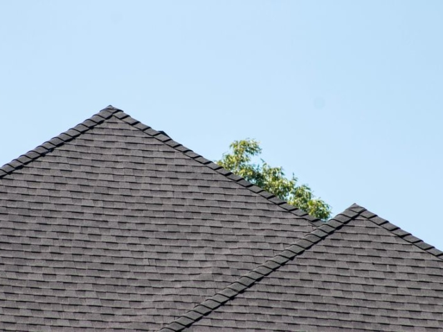 Close-up of a new rooftop with a blue sky above it.
