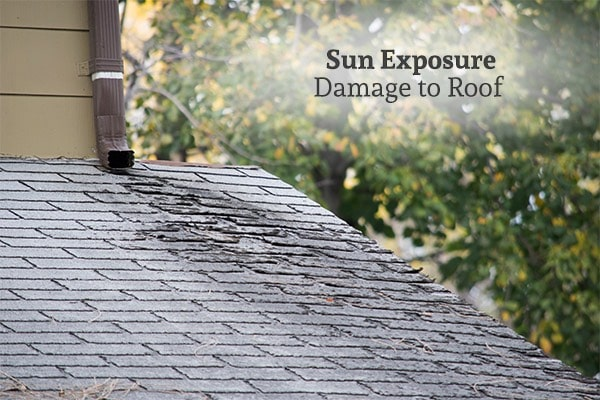 Damage to shingles on the roof of a home, with the words, sun exposure damage to roof