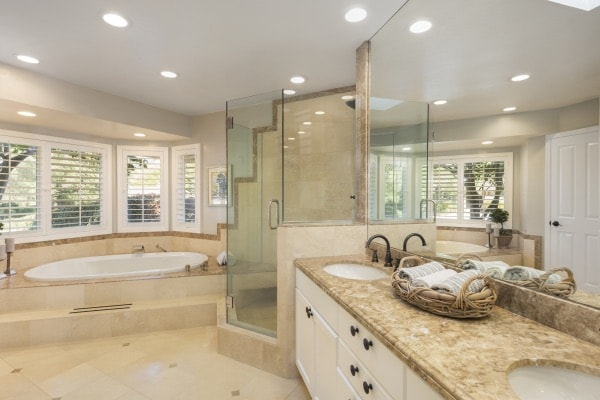 A beautiful bathroom with open spaces, a spa-tub, and a walk-in shower.