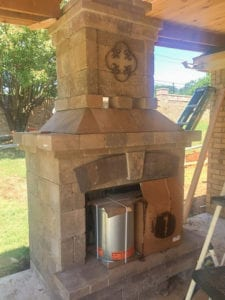 A beautiful outdoor fireplace in the construction phase.