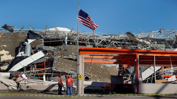 An American Flag waving above the debris of a Home Depot store in Dallas that was ravaged by a tornado