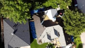 Aerial View Of A New Residential Roof Being Installed On A Home